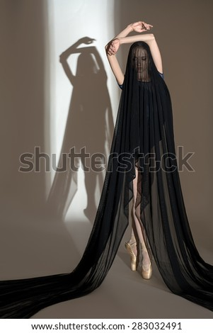 Portrait of the young dancer with a nice black veil cloth - stock photo