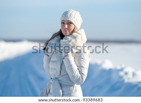 Portrait of the young girl in a cap. Winter