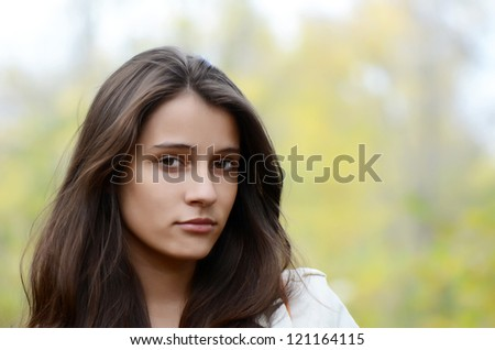 Portrait of the young girl on nature - stock photo