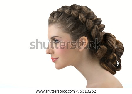 Portrait of the young girl with beautifully laid hair - stock photo