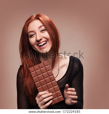 Portrait of the young girl with  big chocolate - stock photo