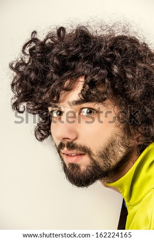 Portrait of the young happy smiling man - stock photo