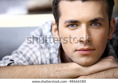Portrait of the young man close up - stock photo
