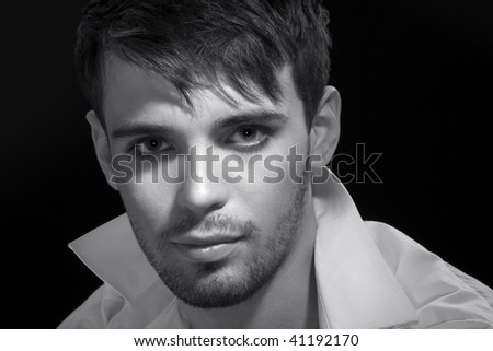Portrait of the young man close-up en face, sight at chamber - stock photo