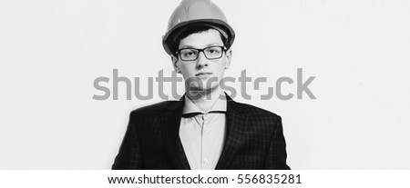 Portrait of the young man engineer on the white background. Black and white photo