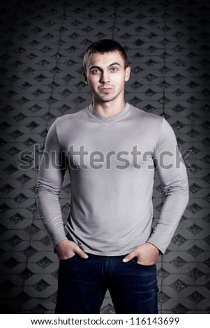 portrait of the young man in a sweater - stock photo