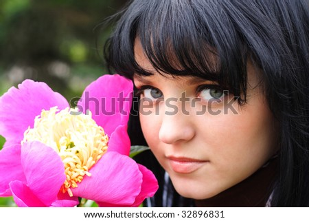 portrait of the young nice girl with a flower