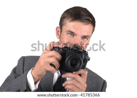 Portrait of the young nice photographer isolated on a white background - stock photo