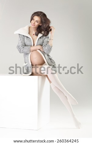 Portrait of the young pregnant woman - stock photo