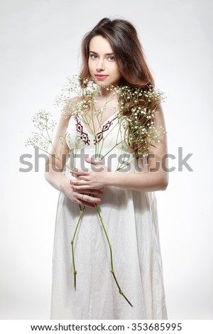 Portrait of the young  smiling pregnant woman - stock photo