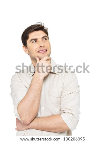 Portrait of the young smiling  thinking man looks up  in casuals isolated on white background. - stock photo