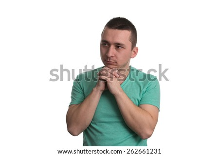 Portrait Of The Young Thinking Man Looks Up With Hand Near Face - Isolated On White Background - stock photo