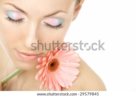Portrait of the young woman blindly and pink gerbera - stock photo