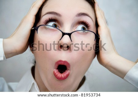 Portrait of the young woman in despair - stock photo