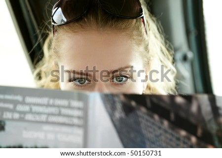 portrait of the young women with magazine - stock photo