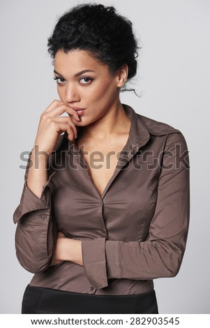 Portrait of thinking african american business woman looking at camera - stock photo