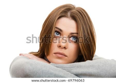 Portrait of thinking and sad woman isolated on  white background - stock photo