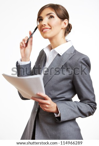 Portrait of thinking business woman with pen and paper, isolated on white background - stock photo