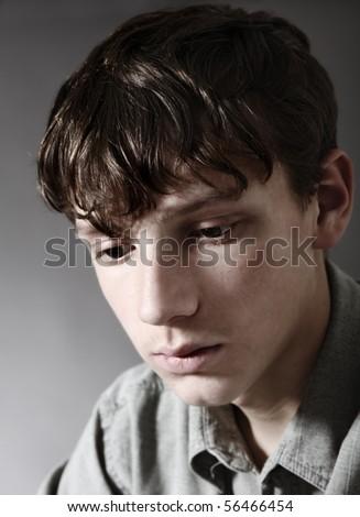 Portrait of thinking teenager - stock photo