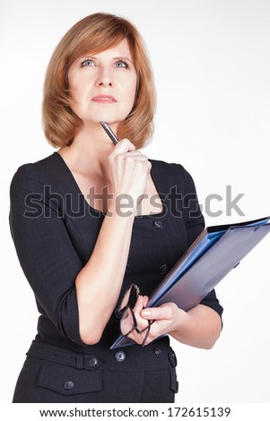 Portrait of thoughtful business woman writer daydreaming. Isolated on white background. - stock photo