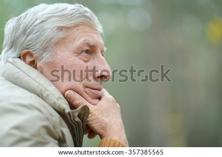 Portrait of thoughtful elderly man in autumn