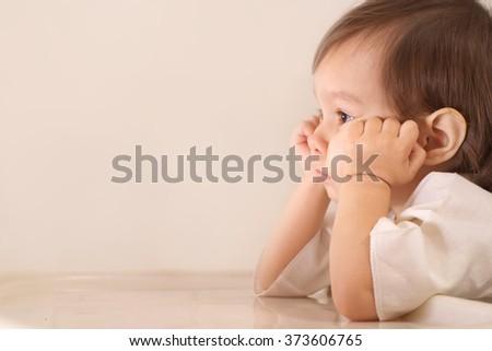 Portrait of  thoughtful little girl - stock photo
