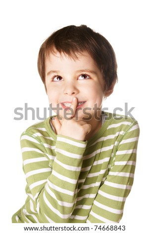 Portrait of thoughtful little smiling boy looking up on white background - stock photo