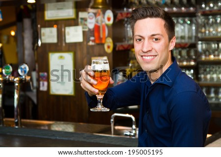 Portrait of thoughtful men drinking beer at the pub - stock photo