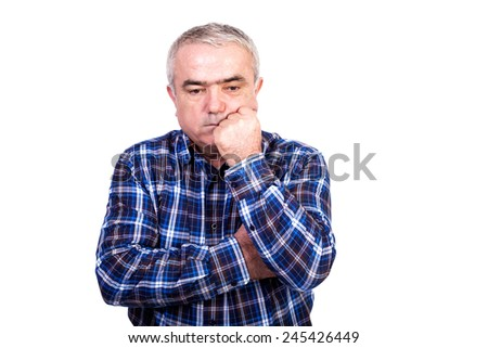 Portrait of thoughtful senior man isolated on white background - stock photo
