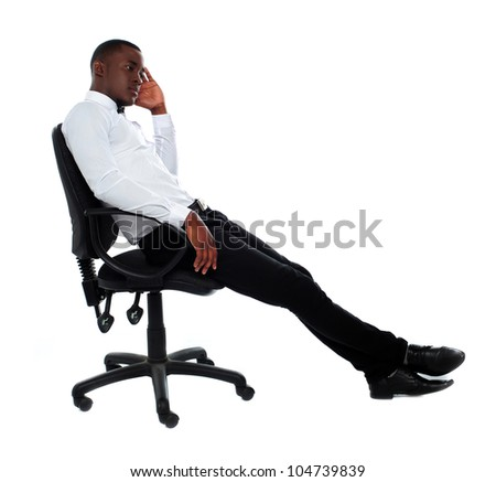 Portrait of thoughtful young businessman sitting on chair - stock photo