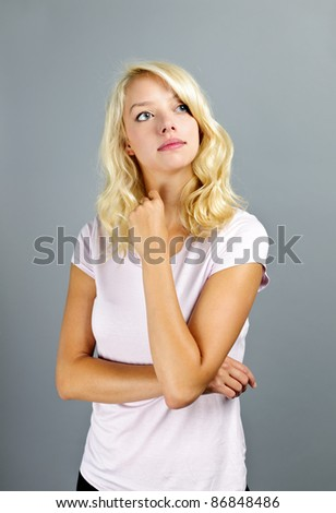 Portrait of thoughtful young caucasian woman looking up - stock photo