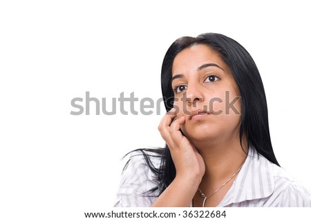 portrait of thoughtful young (indian) woman - stock photo