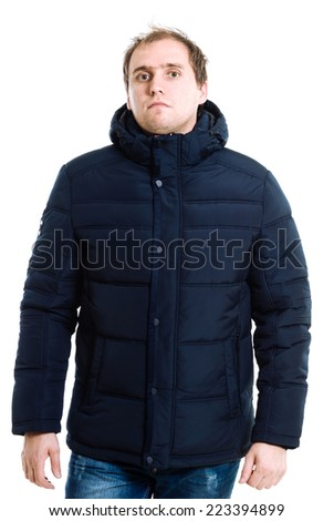Portrait of thoughtful young man in winter coat. Male coat isolated on the white - stock photo