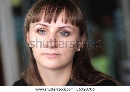 Portrait of thoughtful young woman at cafe - stock photo
