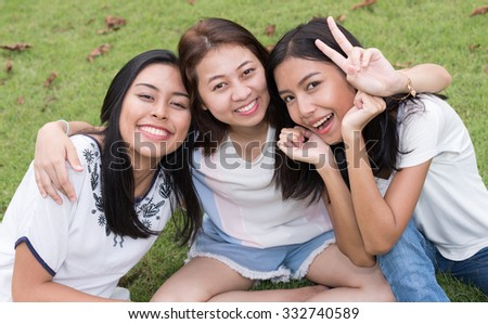 Portrait of three Asian teenager girls - stock photo