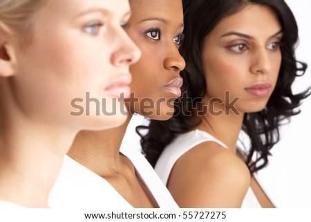 Portrait Of Three Attractive Young Women In Studio Standing In Line - stock photo