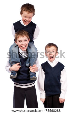 Portrait of three brothers in school uniform, isolation - stock photo