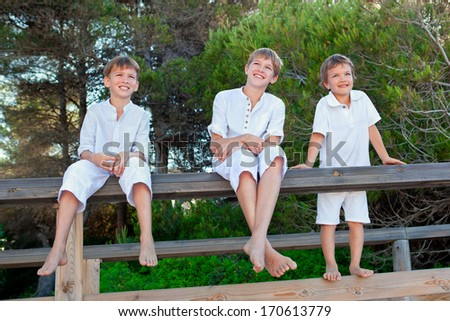 Portrait of three brothers, outdoor - stock photo