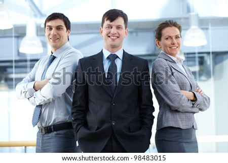Portrait of three business partners looking at camera with smiles - stock photo