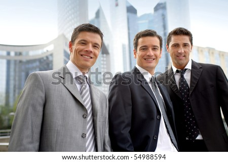 Portrait of three businessmen smiling - stock photo