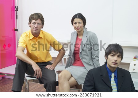 Portrait of three businesspeople posing for the camera - stock photo
