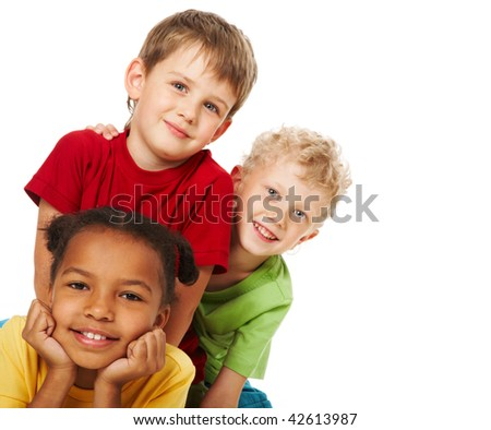 Portrait of three children looking at camera over white background - stock photo