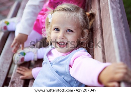 Portrait of three children on the bench - stock photo