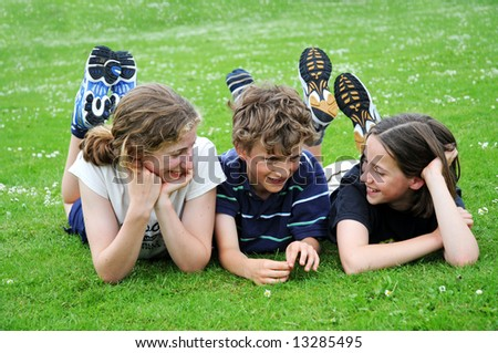 portrait of three children outdoors - stock photo
