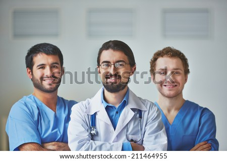 Portrait of three confident medical workers - stock photo
