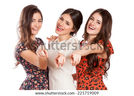 Portrait of three elegant girls looking at camera with smiles  - stock photo