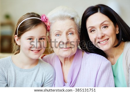 Portrait of three female generations looking ta camera - stock photo