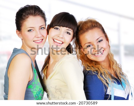 Portrait of three female teenagers friends on white background