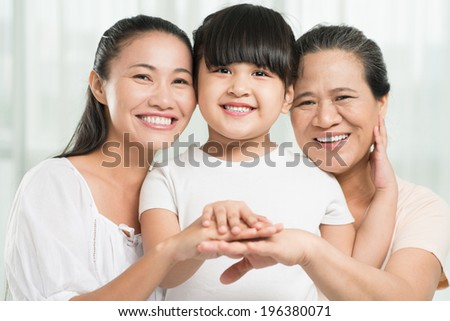 Portrait of three females: grandmother, mother and daughter - stock photo