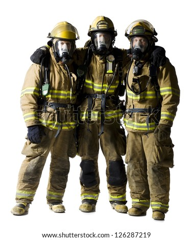 Portrait of three firefighters standing together - stock photo
